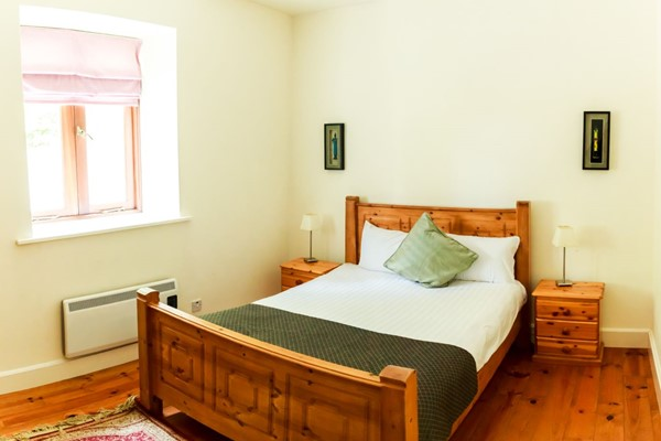 An image labelled 2 Bedroom - Sleeps 4 - 1 Bedroom Ensuite Apartment