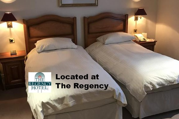 An image labelled Luxury Twin Room