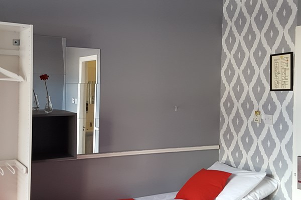 An image labelled 1 Doubles - 2 Singles Large Ensuite Room
