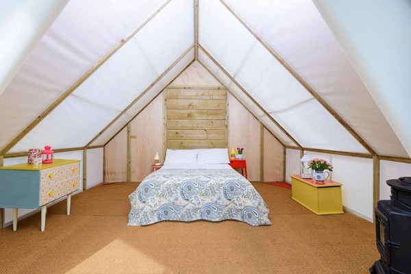 An image labelled Romantic Glamping Suite