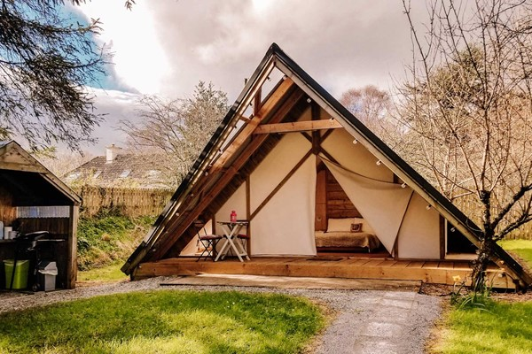 An image labelled Orchard Glamping Suite