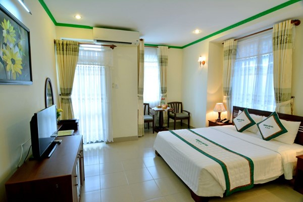 An image labelled Green Deluxe Room