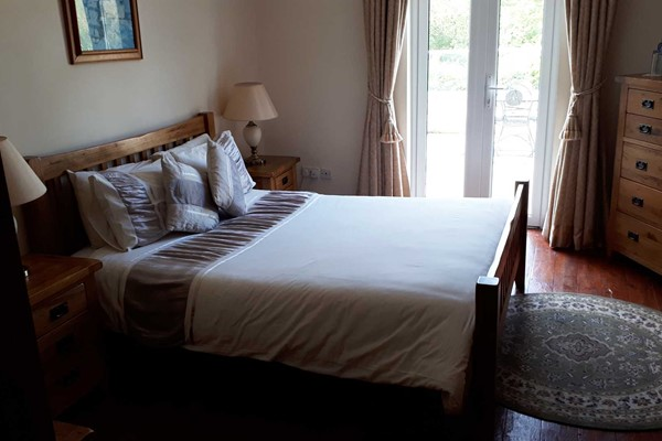 An image labelled Deluxe Double Room