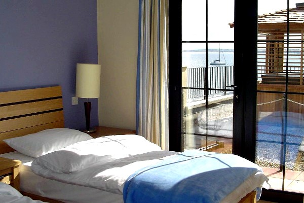An image labelled Twin Harbour View Room