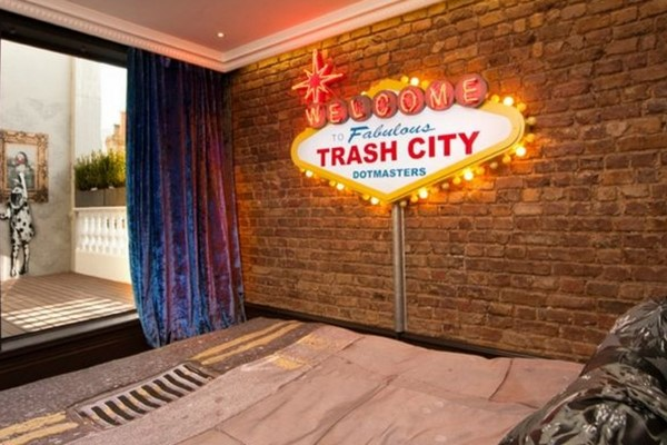 An image labelled Trash City Suite Room