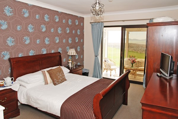 An image labelled Double or Twin - Deluxe Sea Views Room